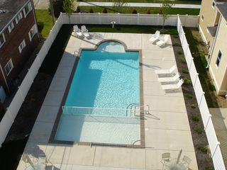 Wildwood Crest condo photo - Pool Area which includes grills, shower and restrooms