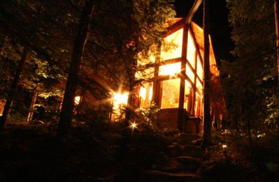The Cabin at night! Over 600 watts of landscape lighting on the property!