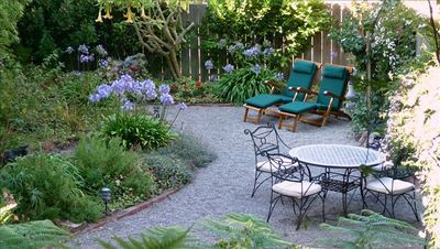 Rear Garden - Mosaic Top Table & Wrought Iron Chairs -Teak Deck Chairs.