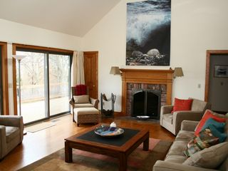 Barnstable house photo - Wood-burning fireplace in living room