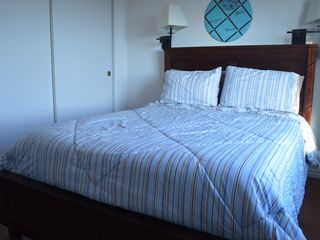 Bodega Bay house photo - Queen size bed in the 2nd bedroom with own TV and window looking out to the bay.