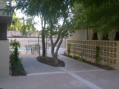 Relaxing Courtyard & Pool with BBQ located below the Unit.