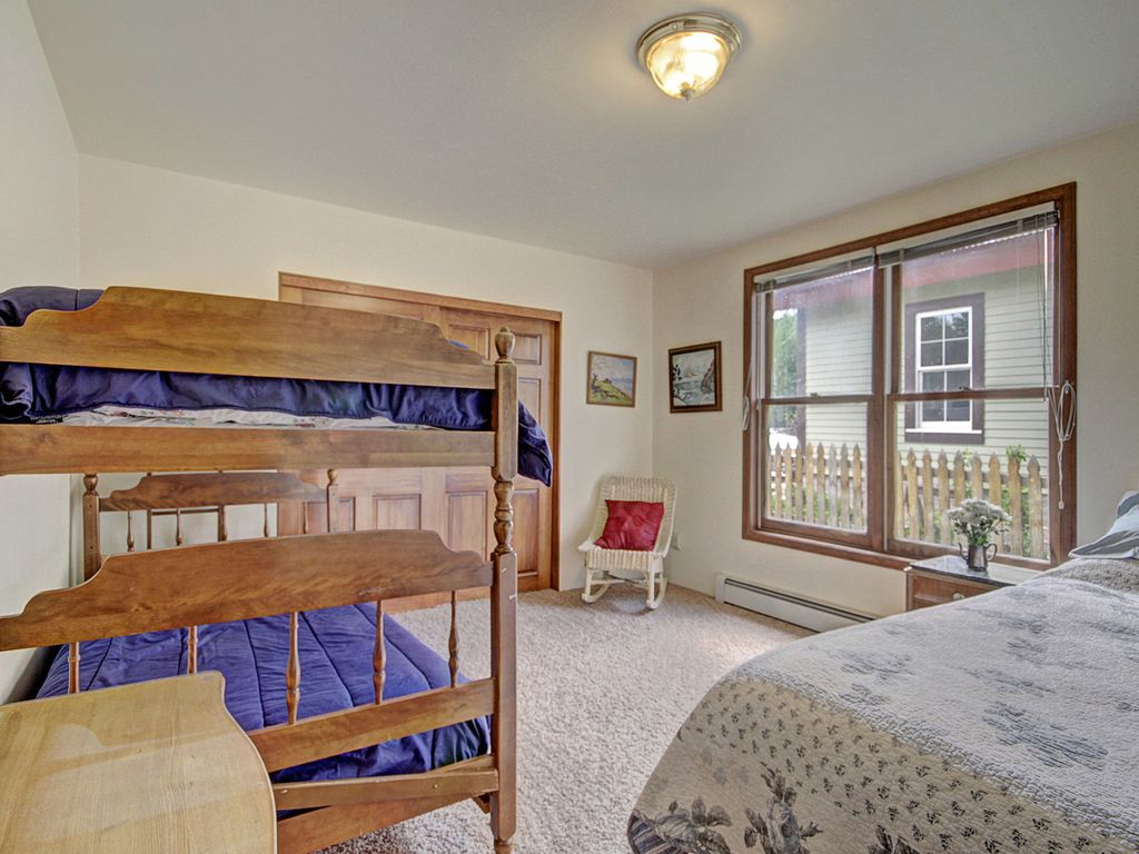 Bedroom 2 with a queen and bunkbeds.  Play space for kiddos.