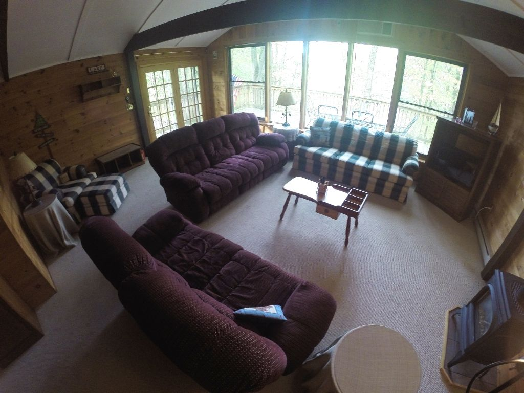 Spacious two story rental in lake wallenpaupack for Living room with lots of seating