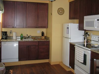 Cape May house rental - 1st floor rear kitchen services the rear dining area & rear porch