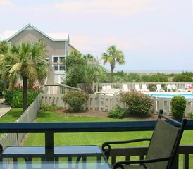 Harbor Island condo photo - Enjoy your favorite beverage or meal or just catch the breeze out on the deck.
