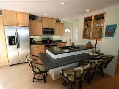 Remodeled kitchen with gas range, pantry, and ice maker.