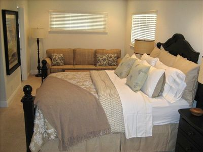 Enjoy your master suite, with sitting area, flat screen tv and walk in closet