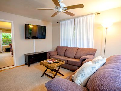 "Living room with 52"" flat screen TV complete with DVD and complimentary Netflix for all guests"