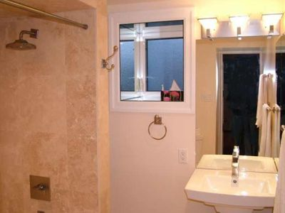 Well lit, Spacious bathroom with quality fixtures
