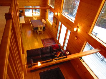 Cooper Landing chalet rental - The dining room and living room are illuminated by a full wall of windows.
