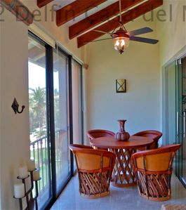 Enjoy Dining on the Screened-in Balcony at Casa Hunter-Hart