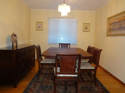 Dining room with expandable table and buffet.  Folding table/chairs upon request