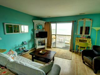 Tybee Island condo photo - I just love the livingroom with sleeper sofa (IKEA) and french desk for writing