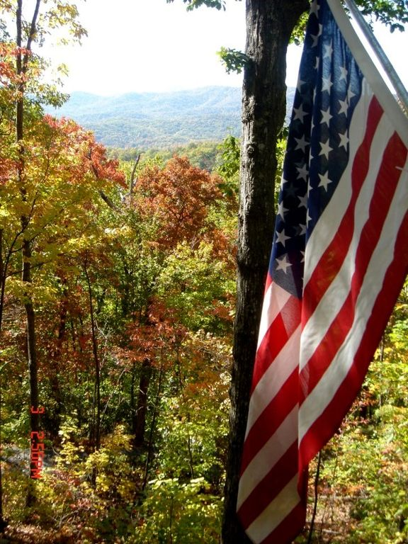 Old Glory and the mountains surrounding the cabin