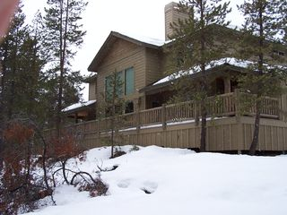 Sunriver house photo - Full-width deck on the back of the house.