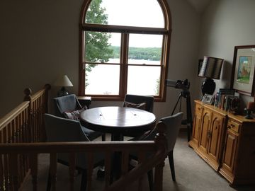Upstairs game table opens for backgammon/chess/cards, full view of the lake.