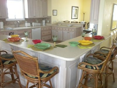 Spacious kitchen offers counter seating for 8.