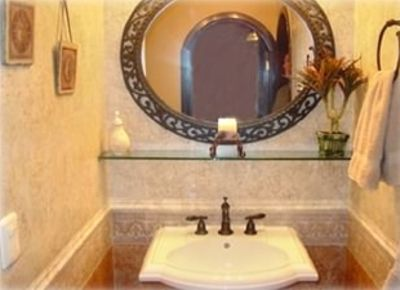 Pedestal Sink and Italian Tile Walls