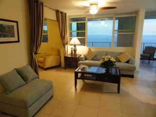 Aguadilla condo photo - Living room with panoramic ocean view