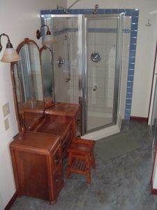 Michigan City house rental - Woman's vanity with glass shower