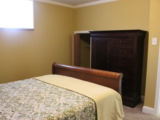 St. Louis apartment photo - Queen sleigh bed with new quilt and armoire and closet.