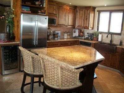 Gourmet kitchen with stainless appliances, 6 burner dual fuel stove, granite