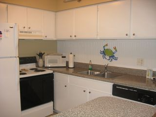 St. Simons Island condo photo - Fully equipped kitchen with granite counter tops.