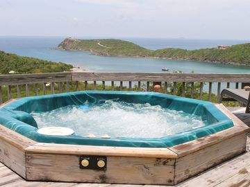 'Hot tubbing' with a panoramic view of Fish Bay and the Caribbean Sea.
