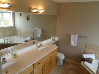 Calgary house photo - Calgary Vacation Home ensuite; jetted tub, clean and bright