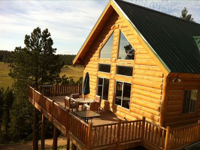 Situated on the side of a hill, the cabin offers a majestic view of the valley