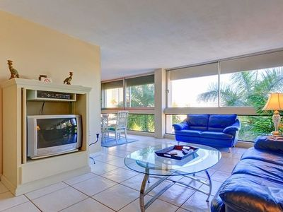 Relax and enjoy our living room with views and tile floors