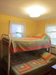 bedroom two with a double bed bottom and twin bed top bunk bed