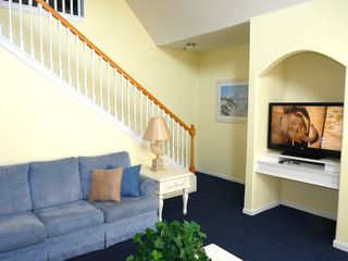 Runaway Beach Resort condo photo - Living room with stairs to escape to the loft, Large flat-screen TV