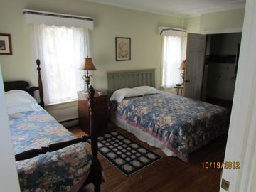 Large downstairs bedroom with two double beds.