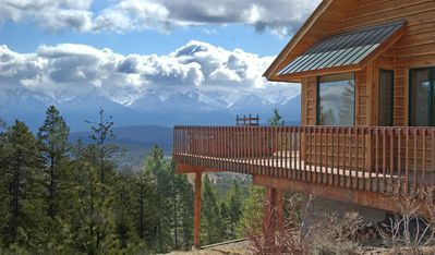 View from deck of the Mission Mountains, master bedroom window seat and hot tub