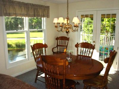 Dining room overlooks woods, lagoon and Shipyard Golf Course