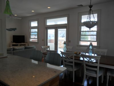 Large dining table in the open first floor adjacent to kitchen