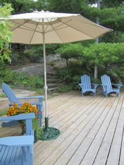 Stoney Lake cottage photo - Swimming dock: sun / shade & comfy chairs for lunch, reading, dock duty, drinks