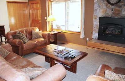 Comfortable Living Room has Gas-Log Fireplace