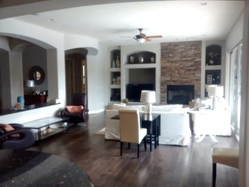 Surprise house rental - main living room great for entertaining opens up to large patio doors to pool.