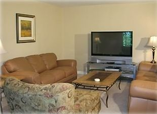 Comfortable family room with leather couches and a 52 inch big screen TV