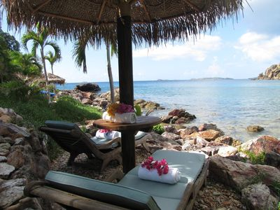 sun loungers and palapa