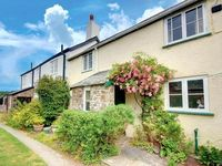 Character cottage in delightful village setting just a quarter mile from the coast and Tarka Trail