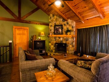 Garfield cabin rental - Livingroom with fireplace and t.v. upstairs overlooking lake.