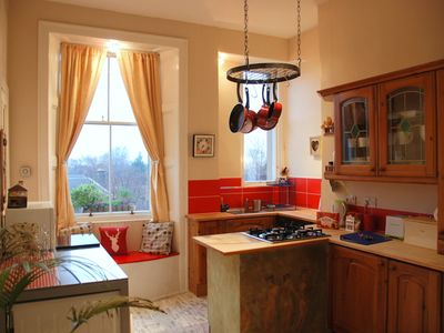 The large homely kitchen has a washing machine, dryer, microwave,dishwasher etc