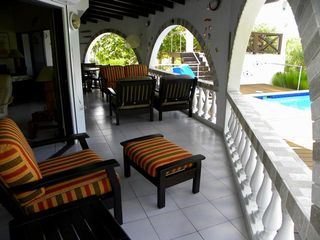 Bonaire house photo - Sit back in the shade, read a book or enjoy a cold drink on the plush patio