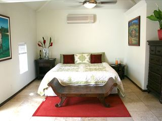 Kailua house photo - Master bedroom with king bed and vaulted ceilings