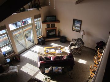 Living room in late afternoon sun, shot from second floor loft