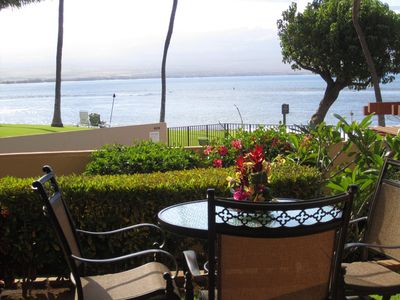 lanai view - enjoy the 4 swivel rockers and dine with a spectacular view